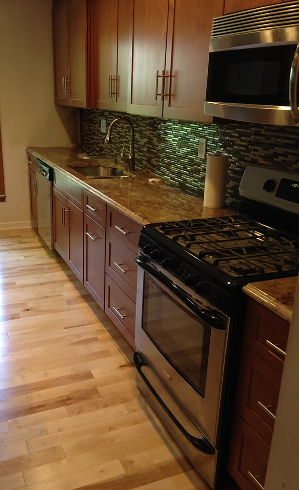 Complete kitchen overhaul featuring granite countertops and tile backsplash