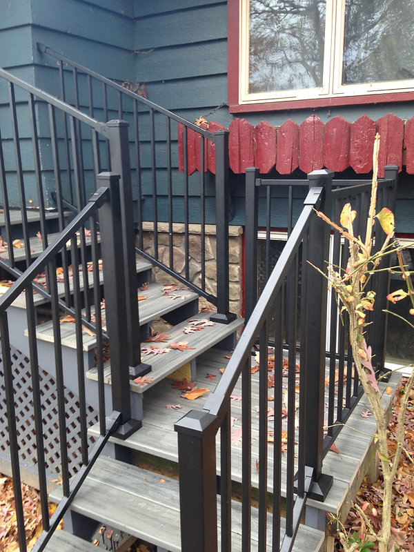 Exterior entry stairs with composite decking surface
