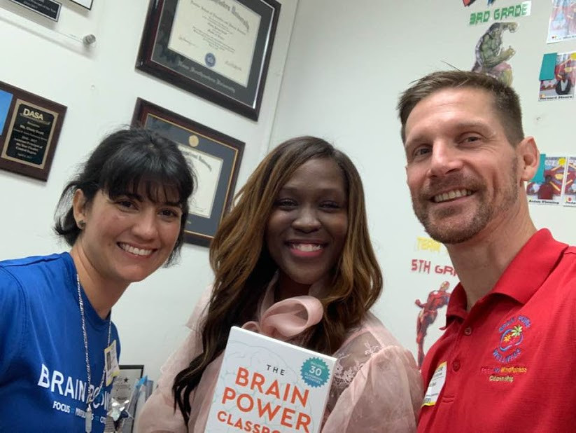 Our Executive Director Dave Beal (right) and Miami Brain Power Field Coordinator Maria Claudia Kondrat (left) with Ms. Scott (middle) from Olinda Elementary in Miami, FL.