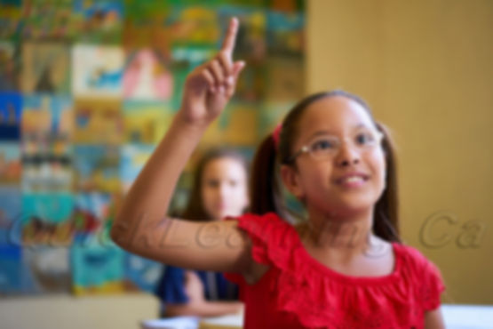 female-student-raising-hand-during-test-