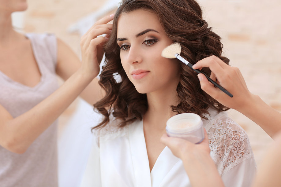Makeup artist and hairdresser preparing
