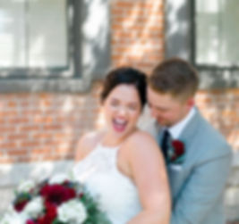Couple having fun with photos after wedding