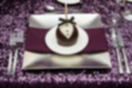Silver charger on sparkle purple linen