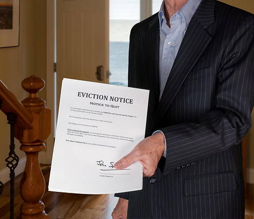 Man in a suit handing an eviction notice