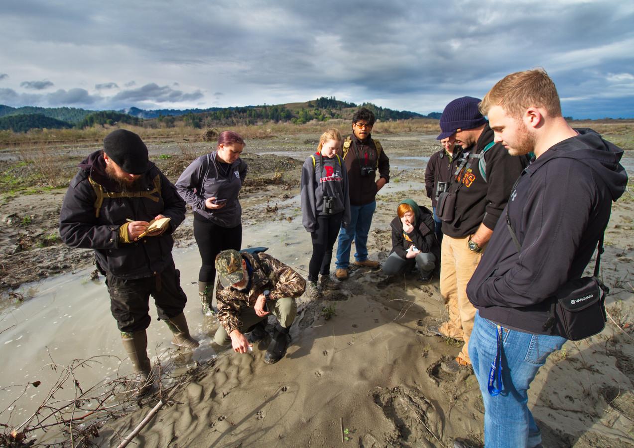 Group at Van Duzen Looking at Tracks.jpg