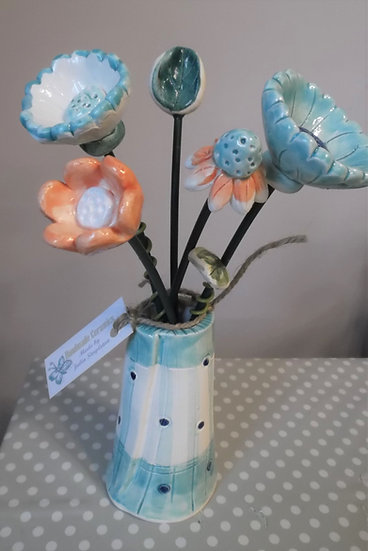 Turquoise spot vase and flowers