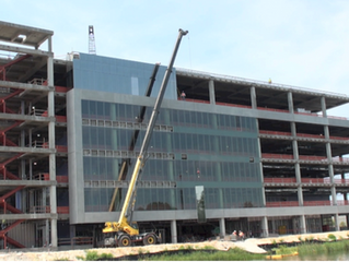 Should you use a unitized curtain wall or a stick-built curtain wall?