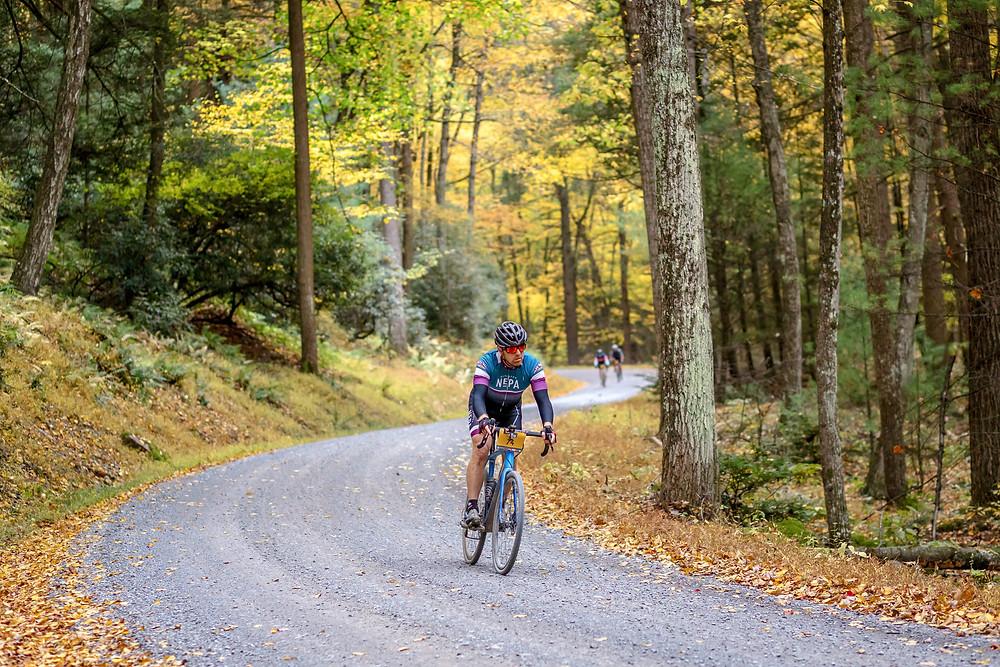 Biker on a gravel trail, gravel bike riding, gravel biking centre county PA, central PA biking, unPAved, bike races in PA