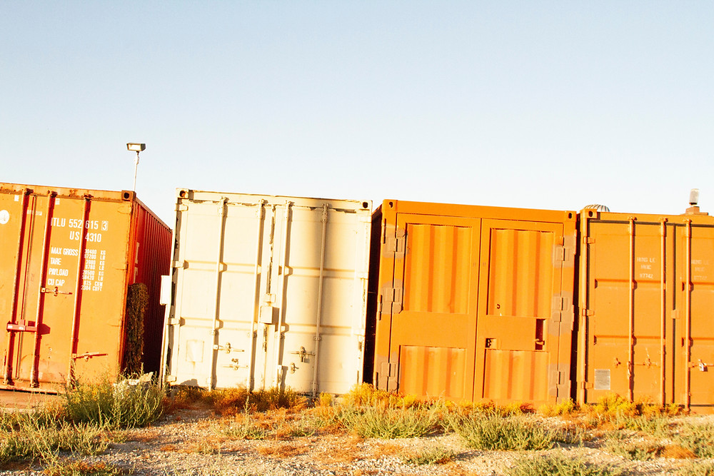 Old shipping containers in the desert