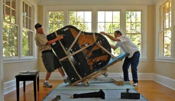 Article_8_Picture_1_two-men-moving-a-piano