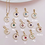 Thumbnail: CZ CRESCENT STAR BIRTHSTONE NECKLACE