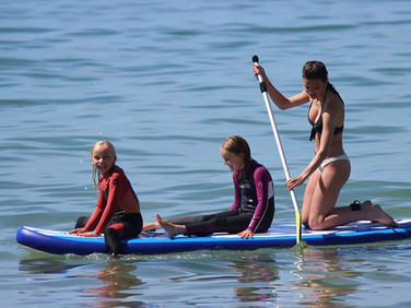 Three girls paddling Strobe SUP