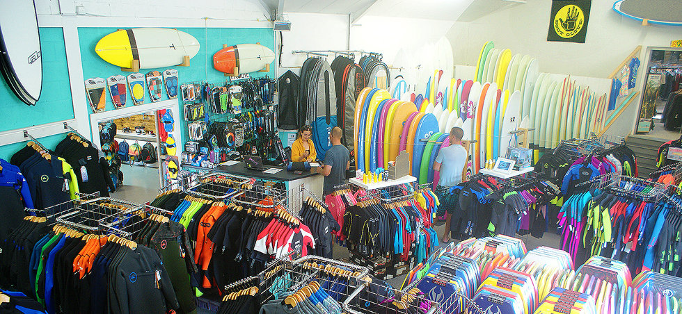 Wetsuit and surfboard section of West Cornwall surf shop