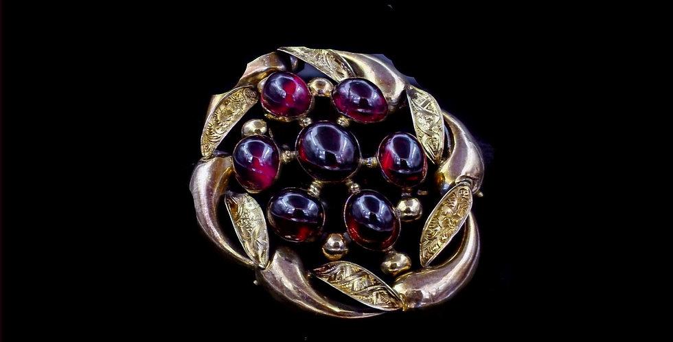 10 to 14K Antique Garnet Brooch