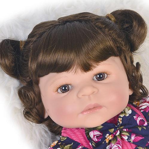 Bebê Reborn de cabelos cacheados