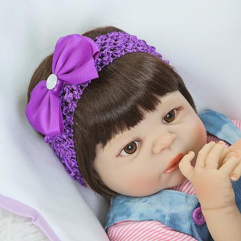 boneca bebe reborn laço roxo macacão toda silicone