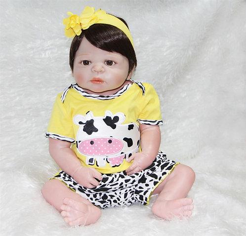 Boneca reborn toda em silicone vaquinha amarela