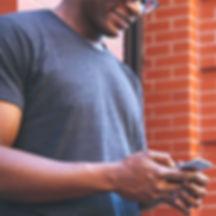 man-using-gray-iphone-Wix.jpg