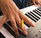 pencil keyboard hands songwriting.jpg