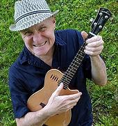 Dave Maloof grimace-smile + ukulele