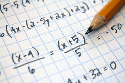 algebra on grid paper with a wooden pencil