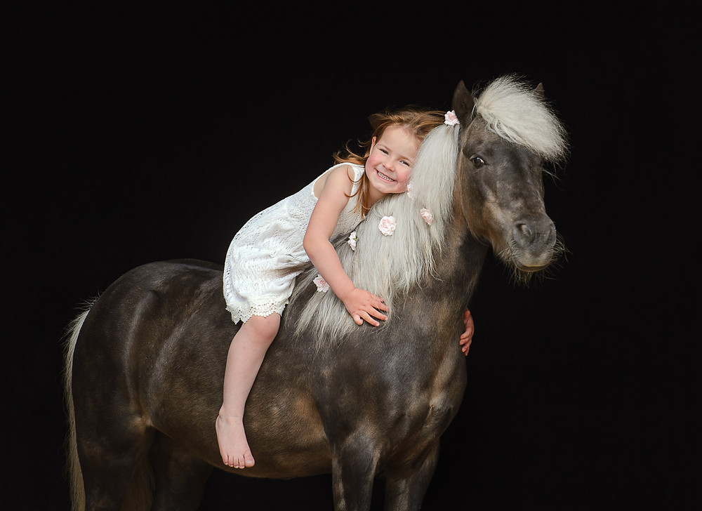 kid with her pony
