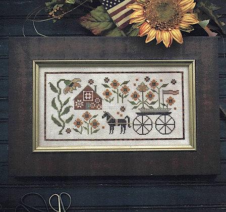*Sunflower House by Plum Street Samplers