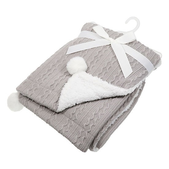 Soft Touch Sherpa backed pom pom cable look blanket