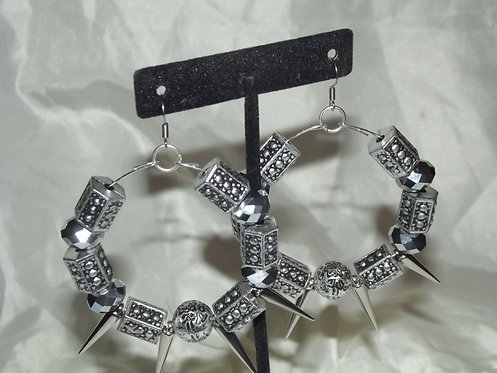 Large silver spike earring