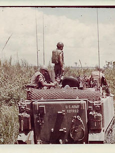 Joe in foreground with young Vietnamese prisoner