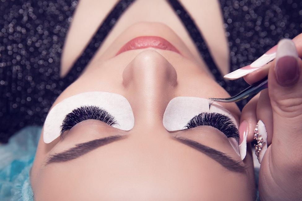 Eyelash extension process. Closeup portr