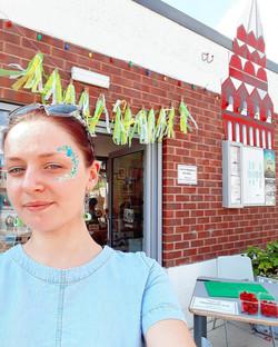 Glittery face festival fun