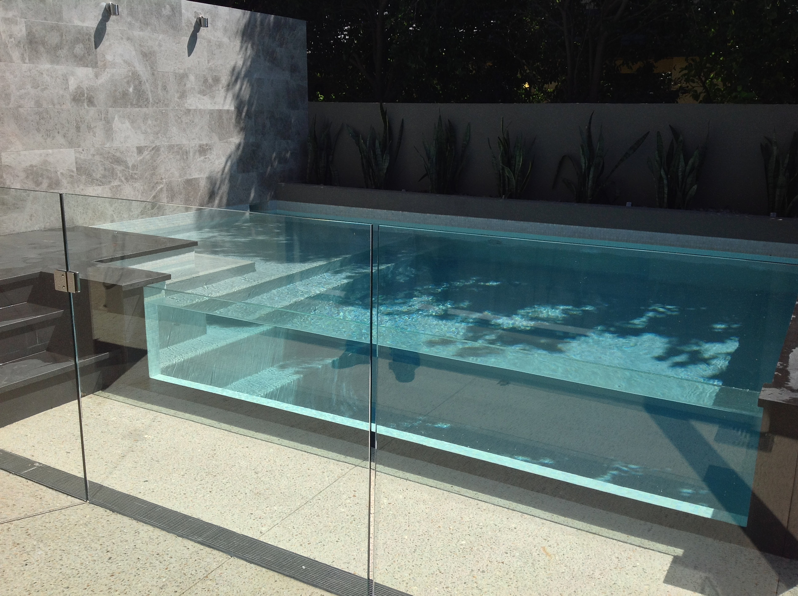 plunge pool design with glass wall
