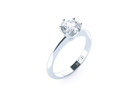 Diamond Solitaire Set in a plain 18ct Gold Band