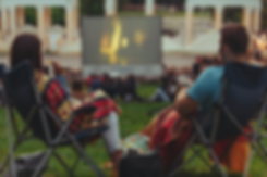 Outdoor Movie Showing Couple.png