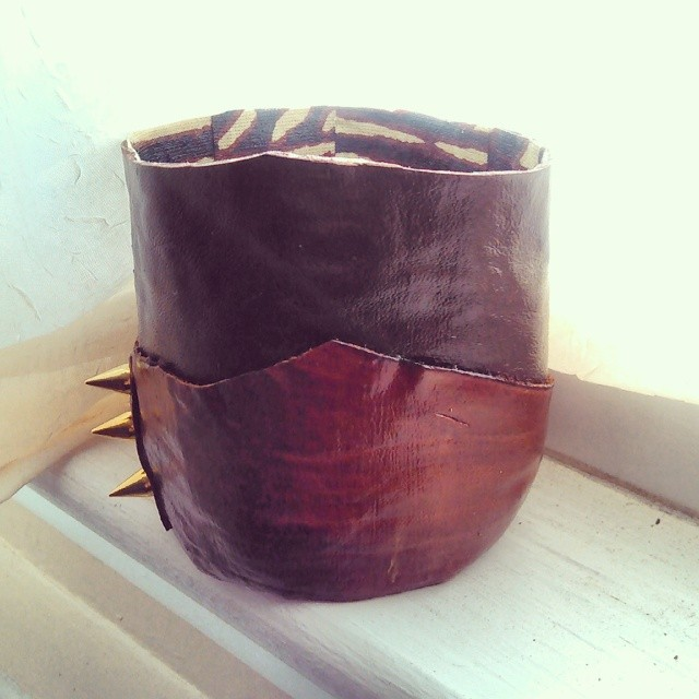 Studded Leather Vessel with Mudcloth