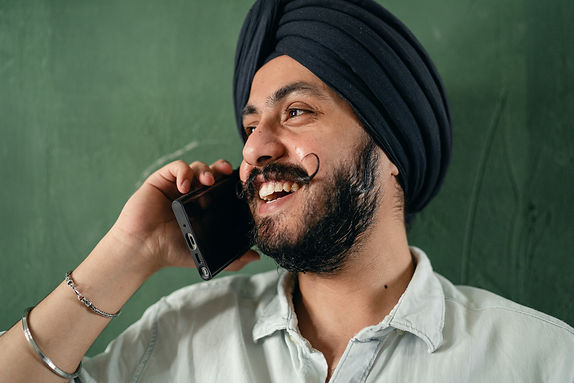cheerful-indian-man-talking-on-cellphone