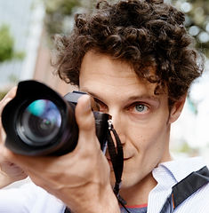 male-photographer-taking-picture-PNWFBPY