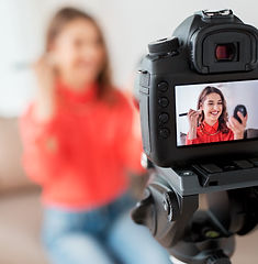 woman-with-bronzer-and-camera-recording-