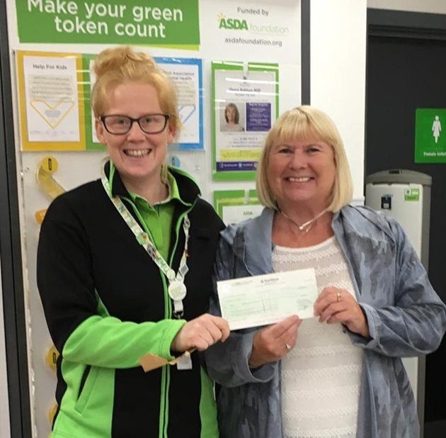 TCS receiving cheque from Asda