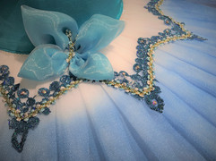 Details of chiffon butterfly, ribbons and crystals