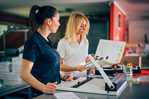 Two young woman working in printing fact