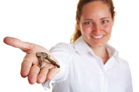 Girl offering keys to your house