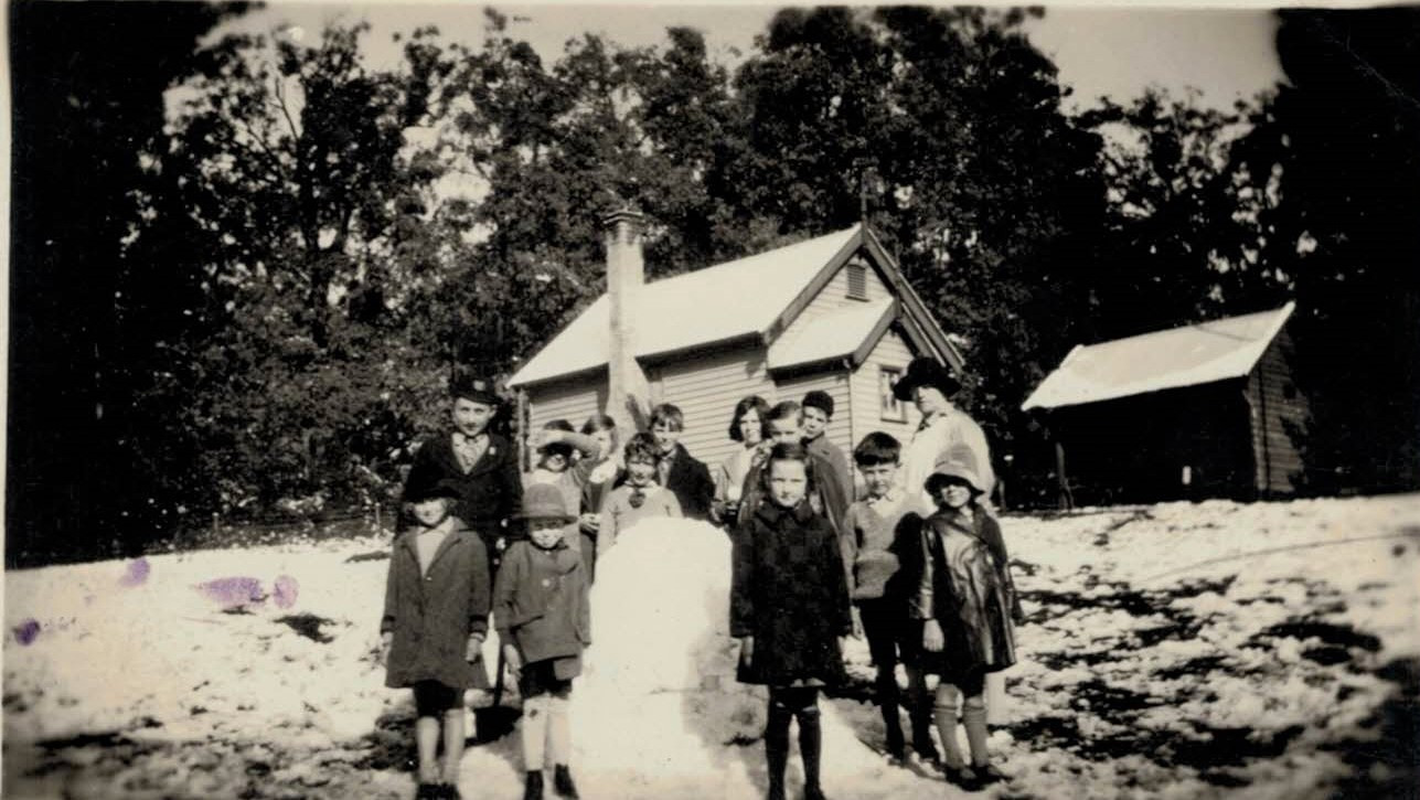 1928 Miss Black with pupils in snow.jpg