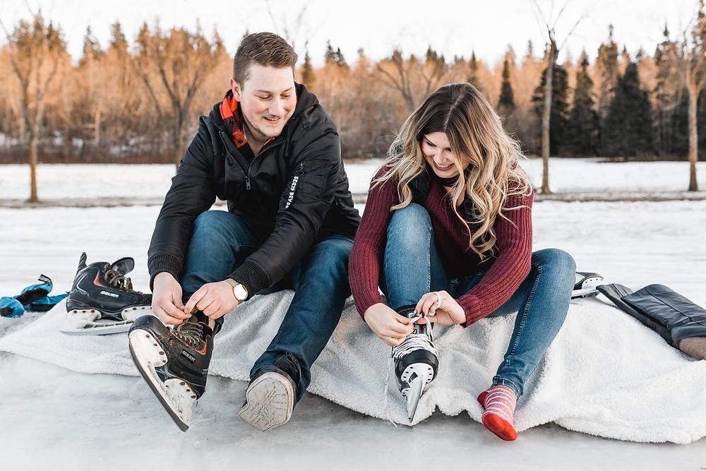 Couple tying skates
