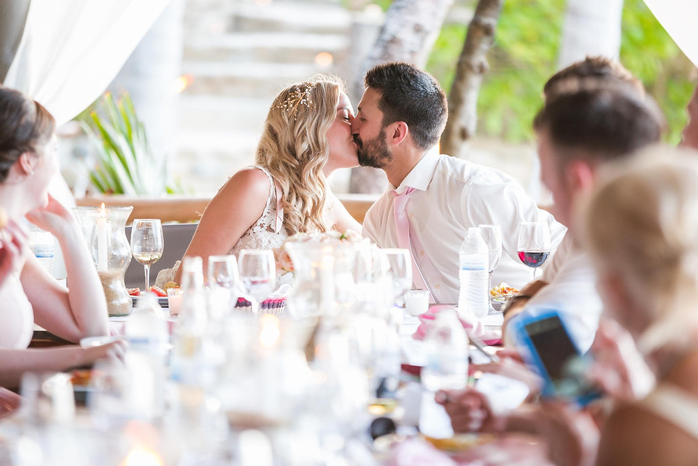 Kissing at the reception