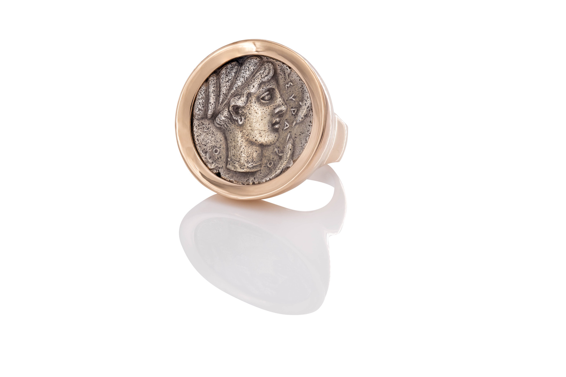 18k GOLD RING |  ARETHUSA  ancient greek coin   didrachma approx. 430-380 a.d.  Arethusa was a nymph and daughter of Nereus, who fled from her home in Arcadia beneath the sea and came up as a fresh water fountain on the island of Ortygia in Syracuse, Sicily. As a patron figure of Syracuse, the head of Arethusa surrounded by dolphins was a usual type on their coins. They are regarded as among the most famous and beautiful Ancient Greek coins.
