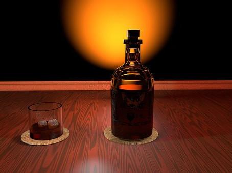 La botella de Whisky.