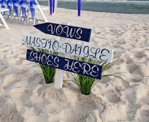 Love this handmade sign for this beach wedding!