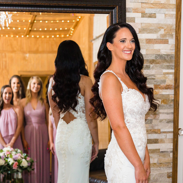 This mirror picture is gorgeous! Capturing everyone's reaction, along with her dress and flowers!